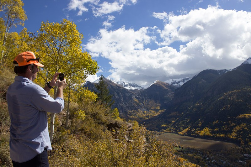 Gear Forum Organizer Todd Walton shooting a photo during a hike on the Jud Wiebe trail.