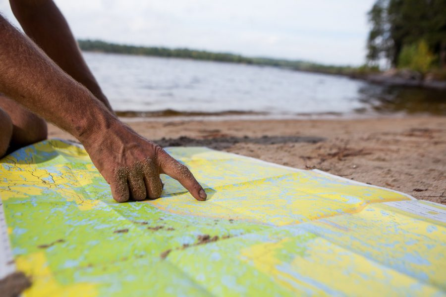 Guide with map in Minnesota's Boundary Waters